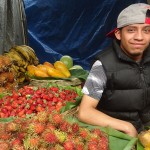 chichi june 2015 man selling fruit and vegetables and smiling