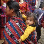 chichi june 2015 woman carrying baby